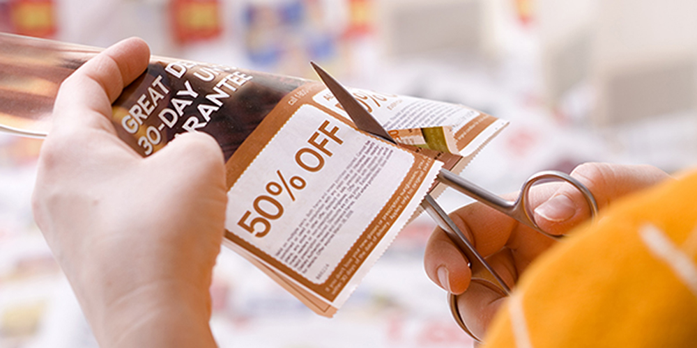 cutting out a coupon to save for an expensive purchase